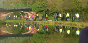 Riders approaching the Boat Museum along the canal in Ellesmere Port